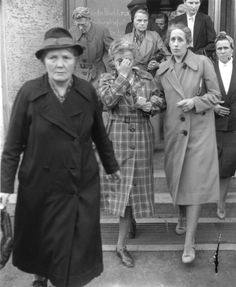 """Burgsteindorf, Germany, German women on their way out after a screening of the film """"Atrocities: The evidence"""" about the Horrors of the camps, 30/05/1945. The conquering forces of the British army forced the local population to watch films about the horrors commited by the Nazi government. At the same day, around 4000 residents of the village Burgsteindorf were forced to watch a movie containing scenes from the liberation of Bergen-Belsen and Buchenwald"""