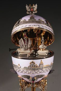 THE 400TH ANNIVERSARY OF THE ROMANOVS ~ The egg was made by Russian artist Andrey Ananov in 2013. The bottom of the egg is decorated by golden image of the Ipatiev Monastery where the history of the Romanovs began. The top of the egg is decorated by the image of Kazanskiy Cathedral in St. Petersburg where the history of the Romanovs was finished. Surprise of the egg is presented by Tzar's regalia. The cost of the egg is 130,000 €.