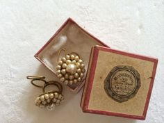 A pair of gilt metal and faux pearl Queen Anne earrings c 1740-1760 in original box with trade label Robertson No 21 Dean St Newcastle upon Tyne