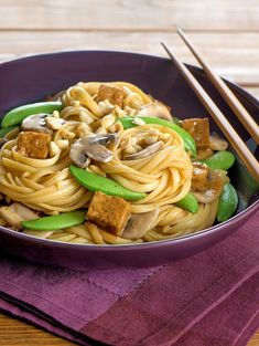 Thai Peanut Tempeh is a vegetarian recipe that you can make quickly and easily on a busy weeknight! Combine our peanut sauce, sesame, oil, and water. Cube tempeh and marinate it in the mixture. Cook your linguine while sautéing mushrooms and snow peas in a large skillet. Then add the tempeh, drain the linguine, and drizzle in the remaining peanut sauce. Once cooked, top with chopped peanuts! #ThaiFood #TempehRecipe #VegetarianRecipe #EasyRecipe #FastRecipe Peanut Recipes, Spicy Recipes, Asian Recipes, Vegetarian Recipes, Vegetarian Dish, Ethnic Recipes, Grilled Vegetable Skewers, Grilled Vegetables, Tasty Thai
