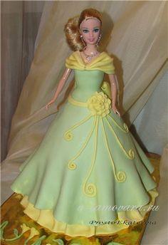 Кукла в зеленом с желтыми цветами и бантом