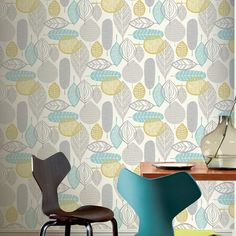 A retro inspired leaf design in grey and teal from Arthouse's Retro Haus Wallpaper Collection. Go Wallpaper UK stock a wide range of Arthouse Wallpaper designs