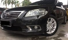 Looking for 2nd hand 2010 Toyota Camry 2.4 V Sedan with TIPTOP CONDITION