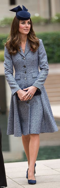 Beautiful tailoring is key to Kate's picks hallmarks and here she wears a tweed Michael Kors coat in Australia