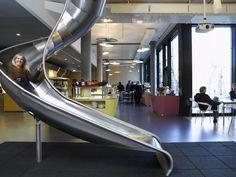 Slide installed in office complex, Zurich Switzerland. Zurich, Google Office, Google Headquarters, Indoor Slides, Innovative Office, Creative Office Space, Office Spaces, Best Places To Work, Office Pictures