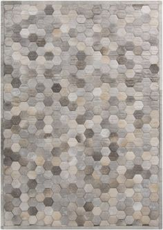 Piece by piece, this leather geometric rug design is patched together and quilted to add a soft 3D effect (Polar PLR-2000).
