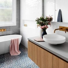 We're loving the colour and pattern in these tiles mixed with this #scandi bathroom- who agrees? #question designed by @gia_renovations #love