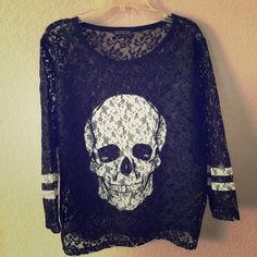"""Express skull lace top! Awesome awesome!  So tough and tomboyish with the skill and the jersey, but then soooo feminine and girly with the lace and that awesome fit and cut.  A great piece to have for all kinds of occasions!  Fits larger than a Small, but it all depends on how you want it to fit you.  I'm 5'4"""" 125lbs.  New w/o tags! Express Tops"""