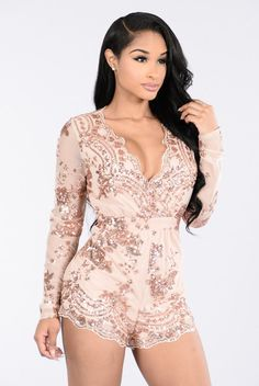- Available in Rose Gold - Long Sleeve Romper - Nude Lining - Sequin details - Scalloped Neckline - 100%Polyester