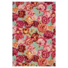 Hooked wool rug with a multicolor floral motif and cotton backing.  Product: RugConstruction Material: WoolColor: Multi Note: Please be aware that actual colors may vary from those shown on your screen. Accent rugs may also not show the entire pattern that the corresponding area rugs have.Cleaning and Care: Rug pad recommended