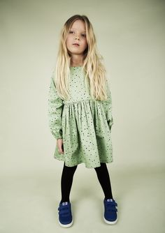 Small-dotted Woven dress made from 100 % organic cotton. The dress is gathered at the waist and has a snap button placket at the back for easy dressing.GOTS certified. Compositon: 100% Organic Cotton.