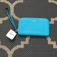Coach Legacy Perforated Leather Wristlet Brand new with tags. Coach Legacy Perforated Leather Wristlet in Robin Blue. Perfect everyday Wristlet with three card slots and one large bill holder. Coach Bags Clutches & Wristlets