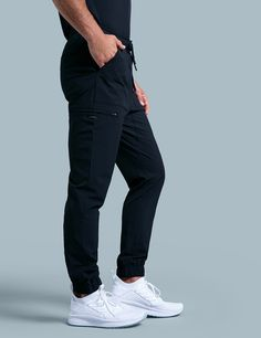 Jogger Pant in Estate Navy Blue is a contemporary addition to men's medical scrub outfits. Shop Jaanuu for scrubs, lab coats and other medical apparel. Scrubs Outfit, Scrubs Uniform, Lab Coats For Men, Jogger Pants Outfit, Doctor Coat, Black Scrubs, Medical Uniforms, Joggers Womens, Medical Scrubs