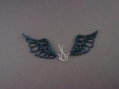 wing earrings.