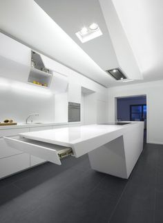 Futuristic hi-tech luxury white kitchen island design with cabinets and built in
