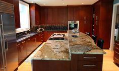 This lovely beige granite is filled with brown veining and spots of gray. It looks beautiful with the rich dark cabinetry.