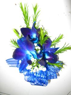blue orchids with baby's breath and honey bracelet corsage