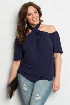 Our plus size Florence Flair Halter Top takes your style to a whole new level. As comfortable as a t-shirt, this blouse flows perfectly and has a unique halter style that shows just the right amount of skin. Browse our entire made in the USA collection at www.kiyonna.com.