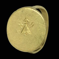 A GREEK GOLD FINGER RING   CLASSICAL PERIOD, CIRCA 4TH CENTURY B.C.   The plain hoop flat on the interior, rounded on the exterior, expanding toward the circular bezel, engraved with a fly
