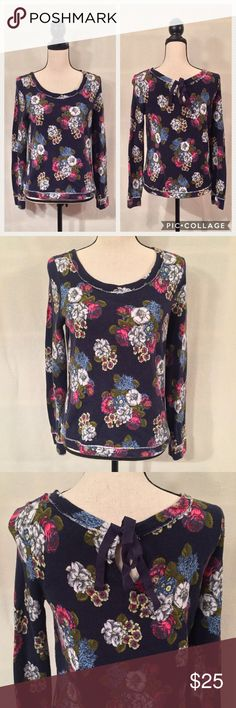"""Saturday Sunday Anthropologie navy floral popover VGUC. No stains or holes. Some wash wear. Saturday Sunday (Anthropologie) navy blue long sleeve pullover with white, blue, pink, and green floral bouquet print. Raw edge on crew neckline, cuffs, and hem. Keyhole at back neck with ribbon closure. 100% cotton (Terry I think). Measurements (flat): shoulder width 15"""", bust 18"""", sleeves 25"""", waist 18"""", length 24"""". Machine wash inside out gentle. No trades. Anthropologie Tops Sweatshirts & Hoodies"""