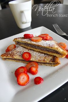 Super Nutella French Toast •2 slices of whole grain bread •1 egg •¼c milk •2 Tsp. of Nutella •Sliced Strawberries