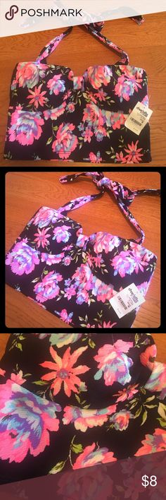 Halted crop top! brand New with tags! Cute little size medium halter crop too from Charlotte Russe. Floral print in neon pink, baby blue, white, purple and black with a hint of green. Super cute! Charlotte Russe Tops Crop Tops