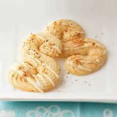 We love spritz cookies for their light, buttery flavor, and eggnog makes a sweet addition. Make pretty swirls and grooves by piping dough through a 1/4-inch star-tip pastry bag, then drizzle with white chocolate./