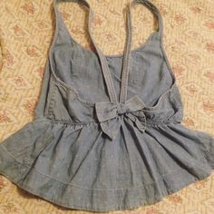 Hollister Denim Tank Subtle polka dot detail with an adorable bow in the back. I wish this top were my size but it's a little too big and deserves a home where it will be worn. EUC. Hollister Tops Tank Tops