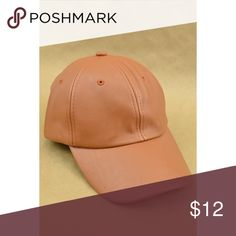 Faux Leather Hat Cute faux leather baseball inspired hat in a camel color.  Adjustable Velcro band in back.  Feel free to make me an offer. Accessories Hats