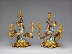 Candelabra with Meissen bird (one of a pair)  Model attributed to Johann Joachim Kändler  (German, Fischbach 1706–1775 Meissen)    Manufactory:      Meissen Manufactory  Date:      ca. 1750  Culture:      Germany (Meissen) with French (Paris) mounts  Medium:      Gilt bronze and porcelain  Dimensions:      Height (overall): 23 in. (58.4 cm) Height (bird): 15 in. (38.1 cm)