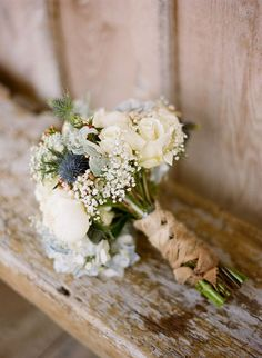 Love the earthy blue grey tones in this and the natural ribbons that piece it together.