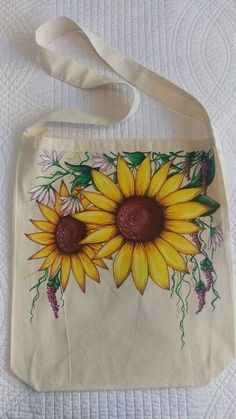 the beautiful hand painted (free hand) fabric tote bag, features bright sunflowers and shimmering purple details. this bag has a long over the shoulder handle and measure at 43 cm high and 38 cm wide Tote Bags Handmade, Diy Tote Bag, Fabric Tote Bags, Canvas Tote Bags, Painted Canvas Bags, Fabric Paint Designs, Hand Painted Fabric, Jute Bags, Cloth Bags