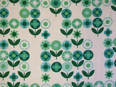 This beautiful 1960s barkcloth fabric is a classic Mod floral design in a fresh palette of greens on white.  Reclaimed from a curtain, it is in amazing crisp condition, with no holes or fading.  There is 1 fat quarter left in stock.