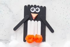 This adorable popsicle stick penguin craft is so easy and fun to make with kids! Grab some popsicle sticks, paint and pom poms and create this cute Winter craft. Popsicle Stick Crafts, Popsicle Sticks, Craft Stick Crafts, Preschool Crafts, Easy Crafts, Diy And Crafts, Kids Crafts, Craft Ideas, Winter Crafts For Toddlers