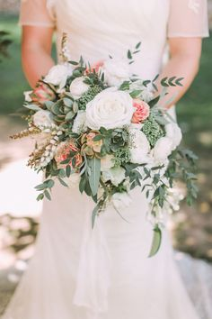 white, peach roses and succulent green wedding bouquets