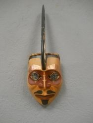 """Killer Whale Mask by Tsimshian Carver from Metlakatla, Alaska.  Carved from Red Cedar and inlayed with Copper and Abalone.  Dimensions 25"""" x  9""""."""