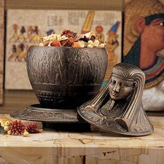 Celebrate the art of the Egyptian Revival with this exclusive, 1920's period collectible, foundry cast in iron from the original antique. The Ritual Plate is embellished with images of stylized cobras while the attached jar bearing the likeness of the pharaoh Imsety opens to hold your keepsakes.  www.ancient-wisdoms.com