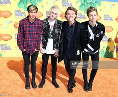 Musicians Calum Hood, Michael Clifford, Luke Hemmings, and Ashton Irwin of 5 Seconds of Summer attend Nickelodeon's 28th Annual Kids' Choice Awards at The Forum on March 28, 2015 in Inglewood, California.