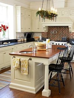 Previous pinner: Wood counter on island – love the brick, plus pretty black chairs, cute towel rack, dark counters, wood floor, white cabinets, tv in corner, well all of it :). Have to agree!  | followpics.co