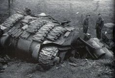 A shattered Sherman tank - It was hit by alternating armour-piercing (AP) and high-explosive (HE) shell . The turret of the tank was blown straight up and off the body . It`s Canadian crew never knew what hit them