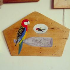 @Simon Sieradzki #artwork #painting on #shaped #wooden #panel #rosella #parrot #bird #avian #egg #bottle $60 Clock, Paintings, Wall, Home Decor, Watch, Decoration Home, Paint, Room Decor, Painting Art