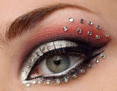 Face jewels to highlight makeup -metallic and red eyeshadow Red Eyeshadow Makeup, Black Eye Makeup, Red Makeup, Brown Eyeshadow, Burlesque Makeup, Gothic Makeup, Belly Dance Makeup, Competition Makeup, Cheer Makeup