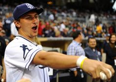 Johnny Football/Baseball hit a homerun during batting practice right before he threw the first pitch at a San Diego Padres game on May 16, 2013. His jersey not only was #2, but a special heisman patch was put on his sleeve.