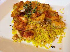 camarão crocante com arroz de ervas, castanhas e amêndoas