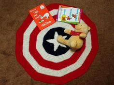 Crochet Baby Blanket - All American. This play mat is perfect for boys or girls. It is a round play mat that shows off your little one's American pride. The pattern is of a tight crochet so it is perfect for playing outside on the grass. I made this one for my daughter to use when we go to the park.