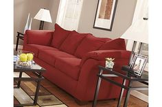 """The Darcy Sofa from Ashley Furniture HomeStore (AFHS.com). With the exciting contemporary style of the sweeping padded arms and plush pillow back design, the sleek beauty of the """"Darcy-Salsa"""" upholstery collection is sure to awaken the décor of any home environment while offering the comfort that you have been searching for."""
