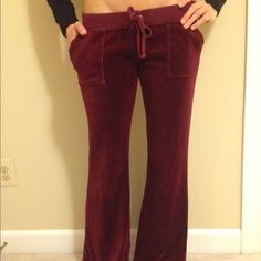 JUICY COUTURE BURGUNDY RED VELOUR PANTS SIZE M Gorgeous Juicy pants. Great condition! Nice burgundy red color. So comfy! Size Medium. Juicy Couture Pants Track Pants & Joggers
