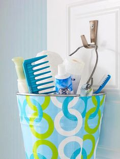 Buckets of fun -- Layer on some bright contact paper and hang a bucket from a door hook for bathroom organization.