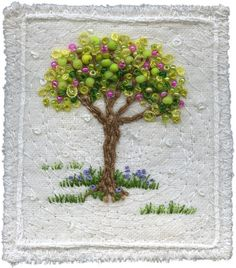 "Adorable little embroidered tree :D I think I would have just done the beads as the ""fruit"" of the tree, but it's such a cute idea either way! <3"