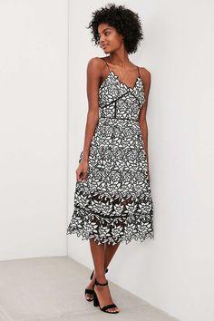 A black and white lace midi dress.